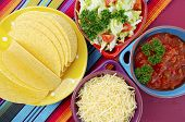 foto of mexican fiesta  - Happy Cinco de Mayo bright colorful party with ingredients for assembling tacos on festive red wood table - JPG