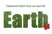 stock photo of planet earth  - Earth Day April 22 concept with outline in green grass with Celebrate Planet Earth sample text - JPG