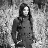 stock photo of overcoats  - Portrait of young beautiful woman in autumn coat - JPG