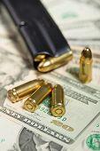 image of corruption  - detail of bullet on US dollar banknotes crime or corruption concept - JPG