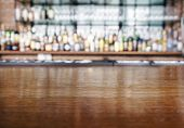 foto of tables  - Top wooden table with Bar Blurred Background - JPG