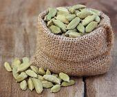 stock photo of cardamom  - Close up of some Cardamom seed in sack - JPG