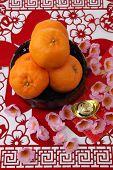 stock photo of mandarin orange  - mandarin oranges on the red paper cutting - JPG