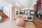 image of enormous  - Spacious bright kitchen with wooden units - JPG