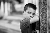 foto of 6 year old  - Six year old boy thoughtfully on wooden jetty  - JPG