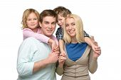 picture of father time  - Cheerful smiling family of four enjoying time together - JPG