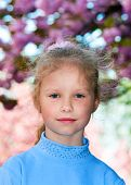Happy Small Girl Portrait Near Blossoming Japanese Cherry Tree