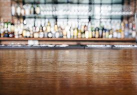 picture of liquid  - Top wooden table with Bar Blurred Background - JPG