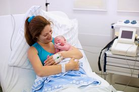pic of bonding  - Mother giving birth to a baby - JPG