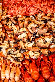 foto of norway lobster  - Various seafood on the shelves of the fish market in Norway - JPG