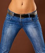 stock photo of saxy  - A young woman in jeans  - JPG