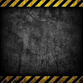 stock photo of warning-signs  - grunge concrete with warning stripe - JPG