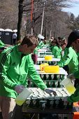 BOSTON - APRIL 18 : Volunteers gave water to runners during the Boston Marathon on April 18, 2011 in