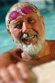 image of older men  - Active senior man in the swimming pool working out in the water
