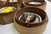 Preserved Egg Dimsum In Bamboo Container Closed Up
