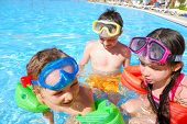 picture of happy kids  - Happy kids playing and having fun together in the pool - JPG