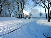 stock photo of winter scene  - Farmhouse on a hill in the snow time in Fyn Denmark - JPG