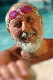 picture of older men  - Active senior man in the swimming pool working out in the water