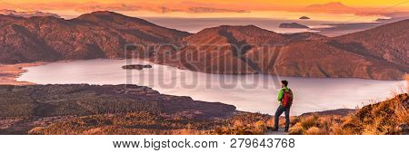 poster of Travel hiking man looking at nature landscape sunset panoramic banner background. Adventure traveler