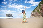 stock photo of woman beach  - beach of Ballota near to Llanes village in Asturias Spain - JPG