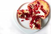 Red Pomegranate Seeds, Pomegranate Kernels, On White Background Pomegranate Fruit In The Plate, poster