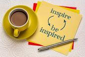inspire and be inspired concept - handwriting on a square reminder note with a cup of coffee poster