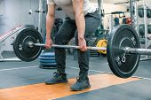 Closeup Of Arms And Legs Of Man Exercising With Barbell At Sport Gym. Athlete, Bodybuilding, Trainin poster