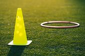 Soccer Training Equipment On Green Artificial Turf With Training Background. Football Training Equip poster