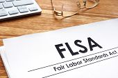 Fair Labor Standards Act Flsa On A Desk. poster