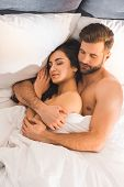 Beautiful Nude Couple Embracing While Sleeping In Bed poster