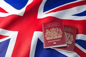 UK passport on the flag of the United Kingdom. Getting a UK passport,  naturalization and immigratio poster