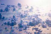 Beautiful View From Window Of Plane Flying Over Clouds And Sea Surface. Natural Panorama With Clouds poster