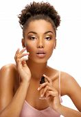 Beautiful Woman Applying Tone Cream On Her Face. Photo Of Young African American Woman On White Back poster