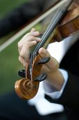 Closeup Of Person Playing Violin