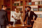 Idea Concept. University Students Discuss New Ideas In Library. Businessmen And Woman Exchange Busin poster