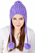 Pretty young woman wearing a purple hat