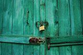 Locked wooden door with padlock