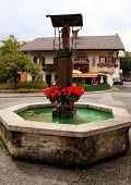 A Typical Bavarian Fountain In Garmisch-Partenkirchen