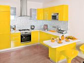 Modern kitchen interior with yellow decoration
