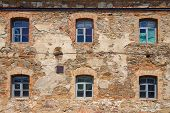 pic of carmelite  - Old orange brick wall with six windows in Monastery  - JPG