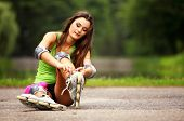 picture of roller-skating  - Happy young girl enjoying roller skating rollerblading on inline skates sport in park - JPG