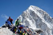 Hikers sitting at the foot of Kala Patthar mountain (5164 m ),Nepal