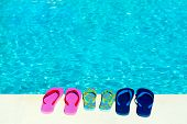 flip flops at swimming pool from the family