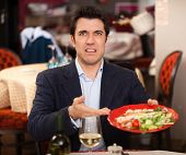 stock photo of revolt  - Man complaining for the bad food - JPG