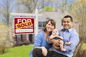 stock photo of yard sale  - Happy Mixed Race Young Family in Front of Sold Home For Sale Real Estate Sign and House - JPG
