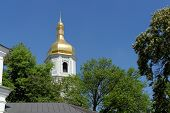 Belfry of the Sophia's Cathedral in Kiev Ukraine above the trees