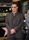 LOS ANGELES - JUN 23:  Johnny Depp arrives to the Walk of Fame Honors Jerry Bruckheimer  on June 23,