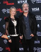 LOS ANGELES - JUN 22:  Gore Verbinski & wife Clayton arrives to the 'The Lone Ranger' Hollywood Prem