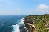 stock photo of dua  - Cliffs above blue tropical sea on Nusa Dua Bali Indonesia - JPG