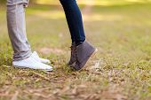 stock photo of adolescence  - teenage couple kissing outdoors at the park - JPG